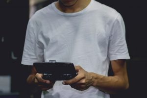 a-smartphone-game-controller-on-a-person-s-hand-2883029